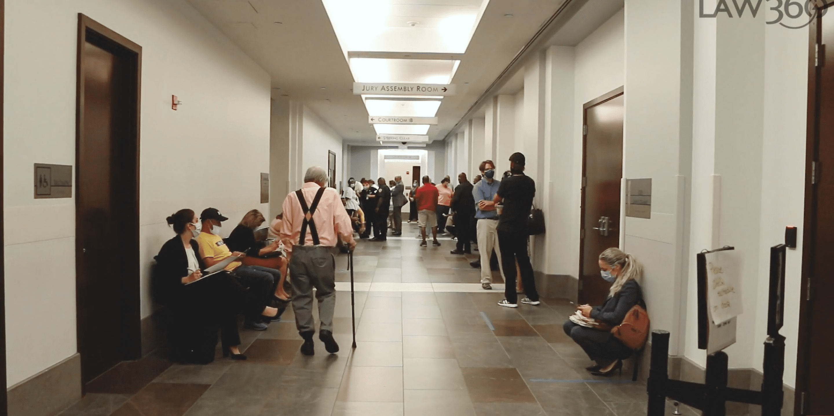 Hallway filled with people in a housing court.